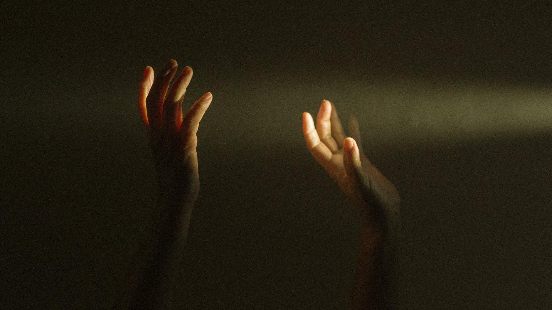 persons raising hands