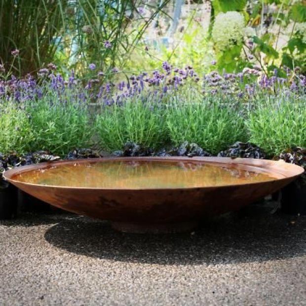 Corten steel water bowl for smaller gardens.