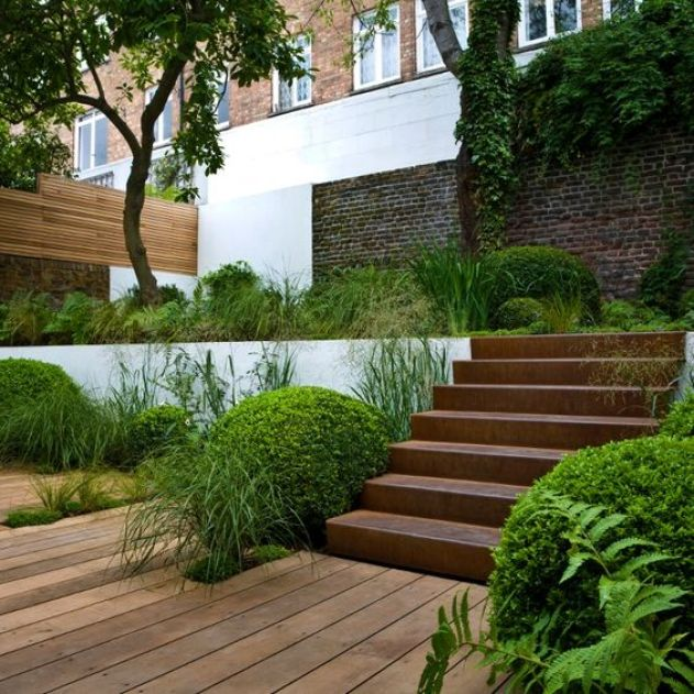 Corten steel stairs in multi level garden.