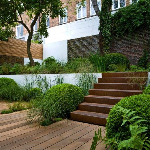 Corten steel stairs in multi level garden.