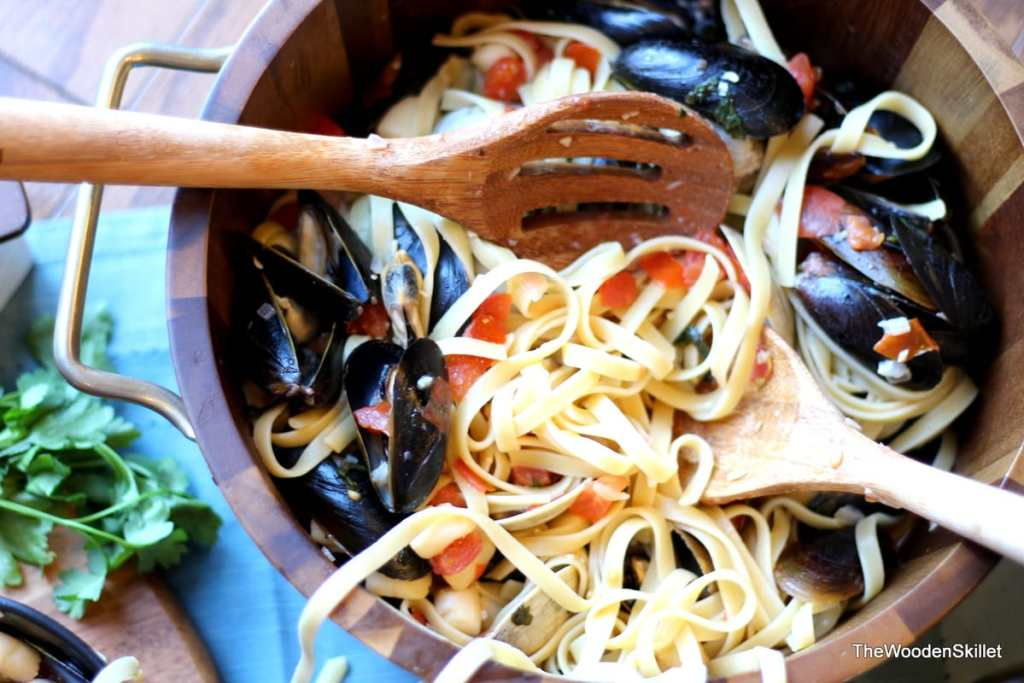 Fettuccine with Mussels, Clams and Bay Scallops in White Wine Sauce - the perfect recipe for seafood pasta and white wine sauce! thewoodenskillet.com #foodphotography