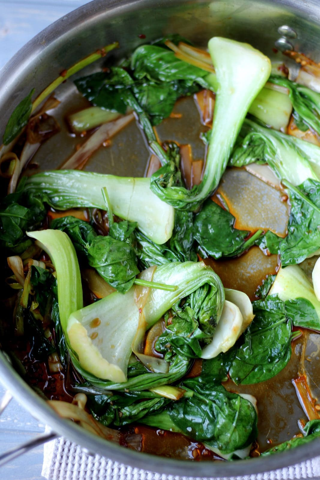Braised baby bock choy, leeks and spinach - thewoodenskillet.com