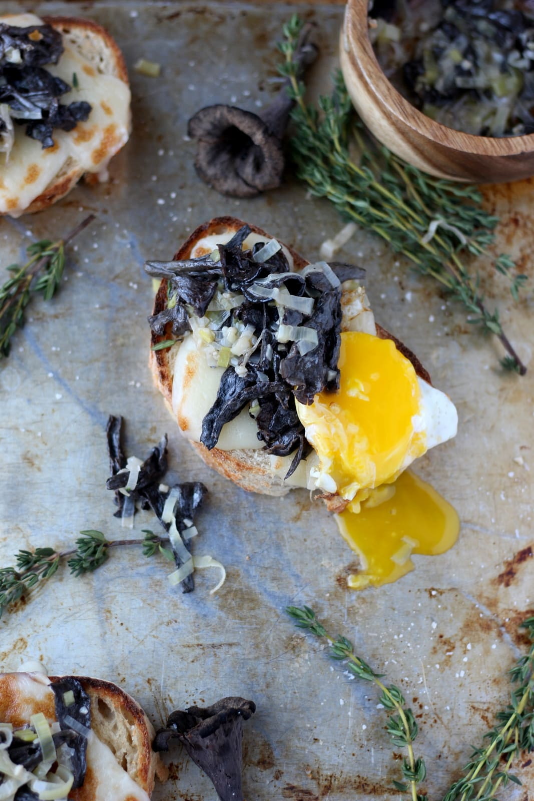 Creamy Leeks and Wild Black Trumpet Mushrooms on Toast with Egg Over-Easy. A great appetizer, small plate or breakfast recipe. Clean eating at its best. thewoodenskillet.com #foodphotography #foodstyling