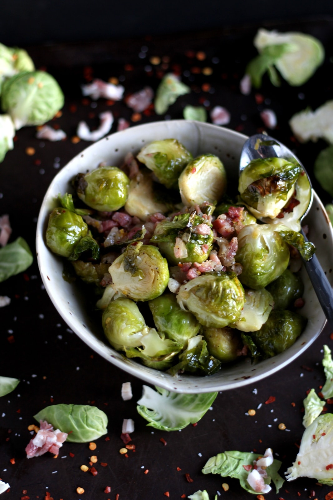 Roasted Brussel Sprouts + Pancetta and Red Pepper Flakes - savory side dish for Christmas or any meal! thewoodenskillet.com #christmasrecipe #foodphotography