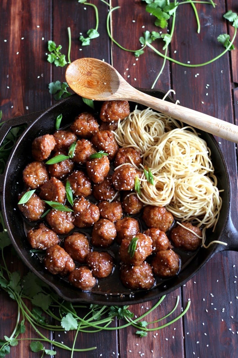 Sesame Soy Ginger Meatballs + Noodles. Easy to make meatball recipe, baked in a soy ginger sauce. thewoodenskillet.com #meatballs
