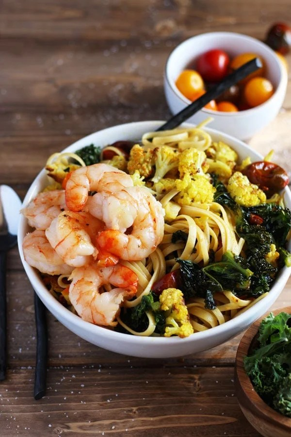 Roasted Turmeric Cauliflower, Kale and Shrimp Pasta + Brown Butter. Simple enough to make on a weeknight, but perfect for a weekend dinner party! thewoodenskillet.com #foodphotography
