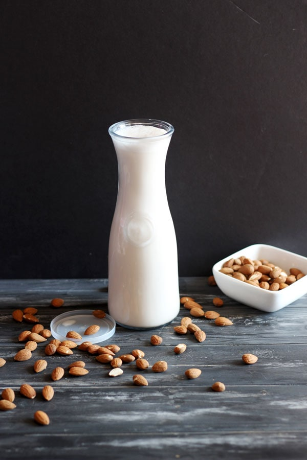 Your Guide to Making Your Best Almond Milk Ever! how to make homemade raw almond milk - thewoodenskillet.com