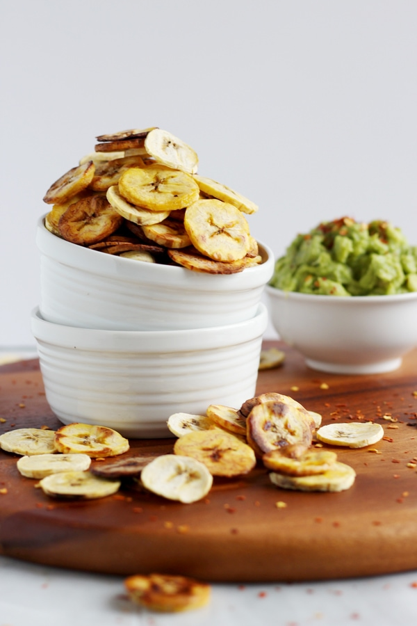 How to Make Homemade Plantain Chips - served with guacamole, these are the perfect healthy, holiday appetizer! #whole30 thewoodenskillet.com