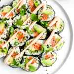 Spicy Salmon and Avocado Cauliflower Rice Sushi Roll - a whole30, paleo and gluten free way to eat sushi! #whole30 #paleo