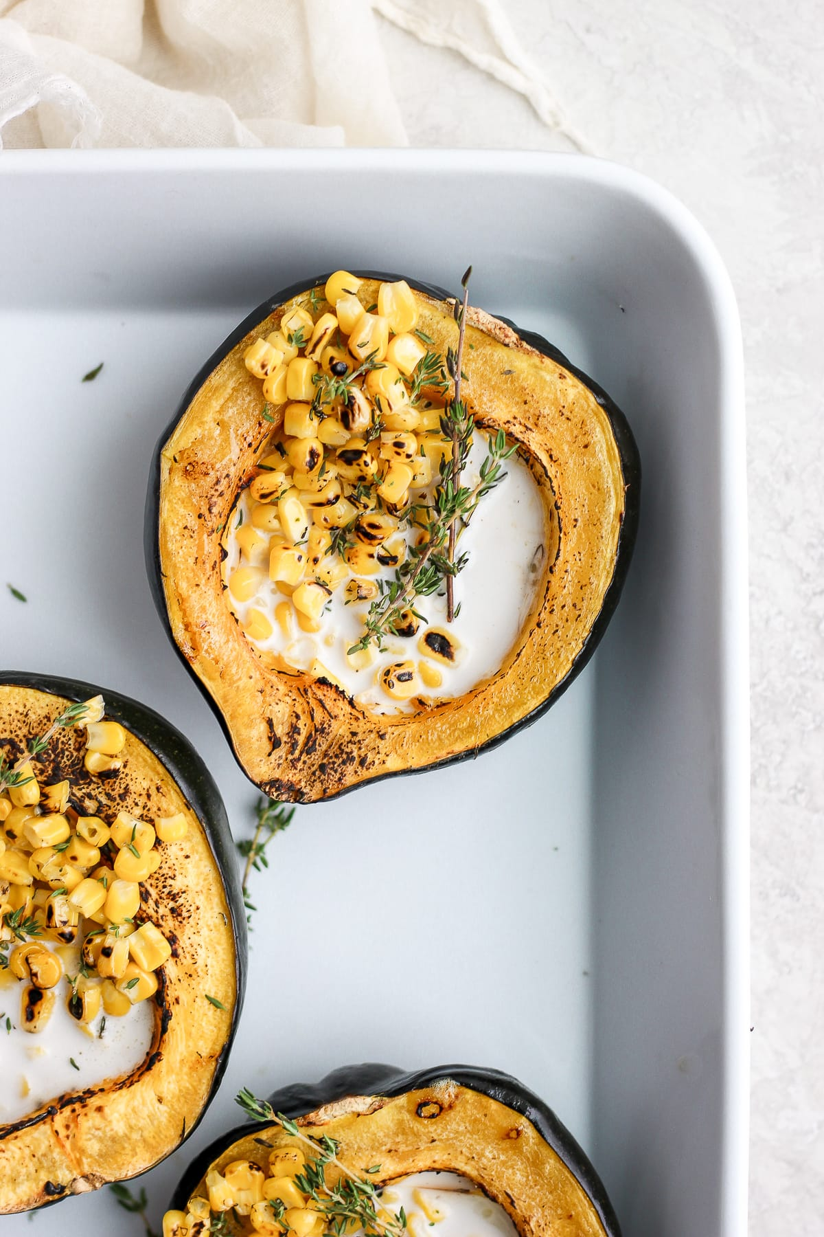 Baked Creamy Acorn Squash - a creamy and delicious side dish that is dairy-free, vegan and gluten-free! #acornsquash #dairyfreerecipes #dairyfree #vegan #plantbased #creamedcorn #foodphotography #christmasdinner #thanksgiving