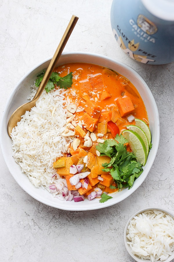 Easy Sweet Potato Curry in bowl with rice and cilantro.