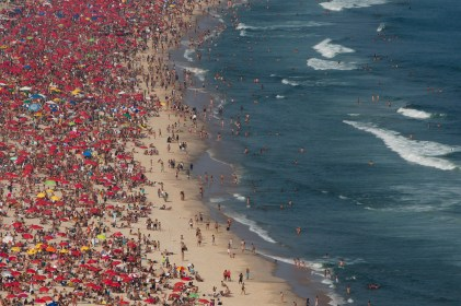 This Sept. 7, 2012 photo shows sunbathers at Ipanema beach in Rio de Janeiro, Brazil. Rio boasts some of the world's most stunning urban beaches and they're worth several visits. (AP Photo/Felipe Dana)
