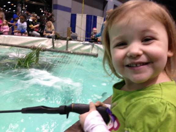Lucia fishing in the trout pond at last year's show
