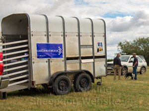 Cancer Research Banner on the secretary's trailer - Evesham Sheepdog Trials 2013