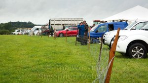 Cars, vans and the judge's trailer at Evesham Sheepdog Trials.
