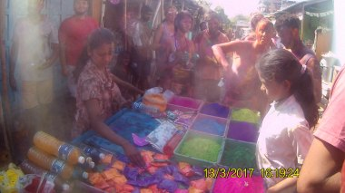 Buying colour paint at Holi