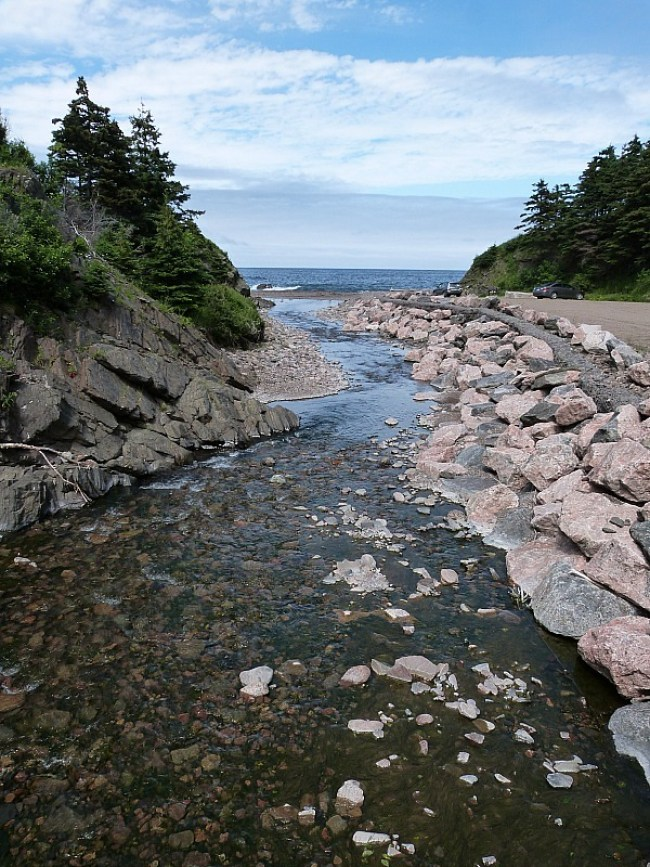 River running to the sea in Meat Cove on Cape Breton Island, Nova Scotia