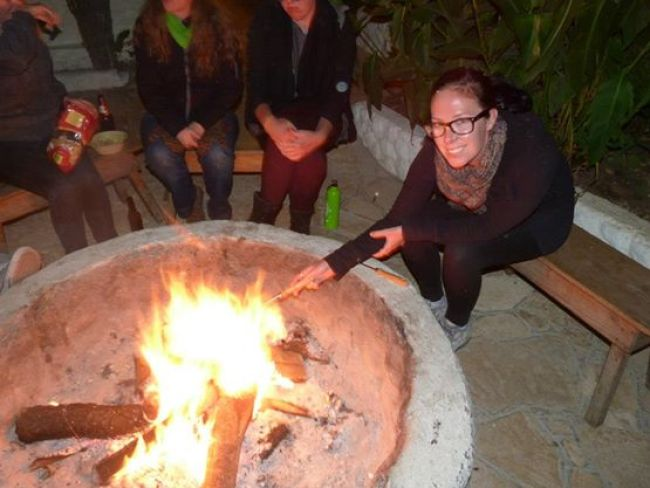 Enjoying the fire pit at Rossco Hostel, San Cristobal de las Casas, Chiapas, Mexico