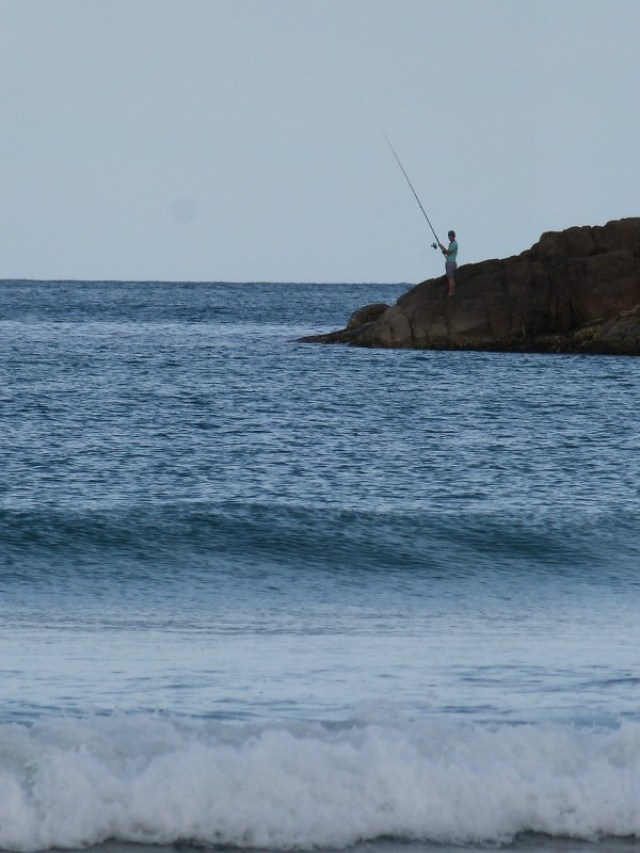Fisherman at One Mile Beach in Nelson Bay