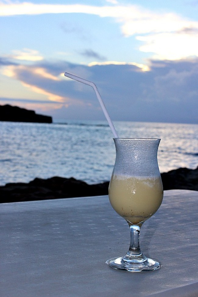 Relaxing with a cocktail at sunset on Barefoot Island in Fiji