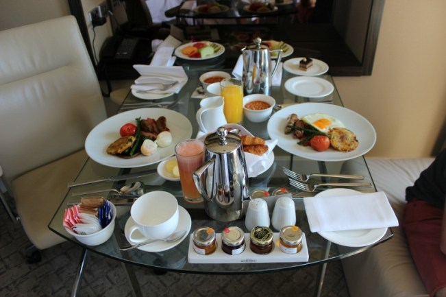 Enjoying cooked breakfast in the room at the Four Seasons during our Sydney Staycation
