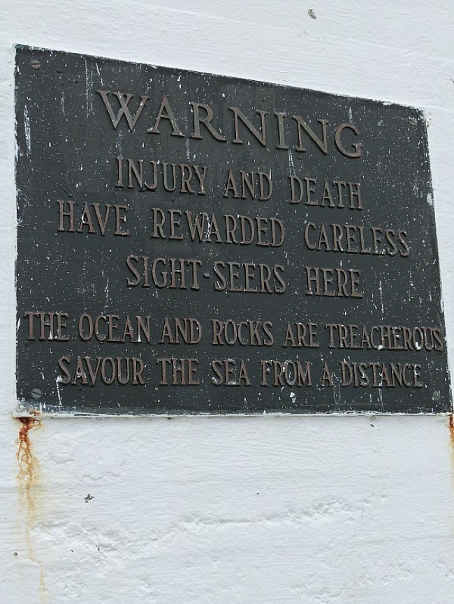 Warning at Peggys Cove Lighthouse