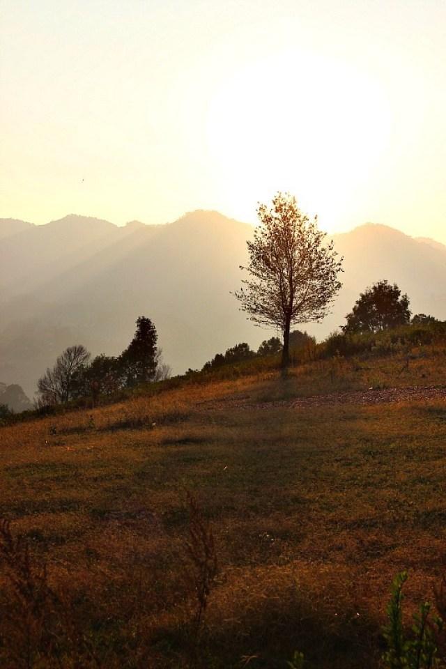 Sun setting behind the mountains during trekking Kalaw to Inle Lake