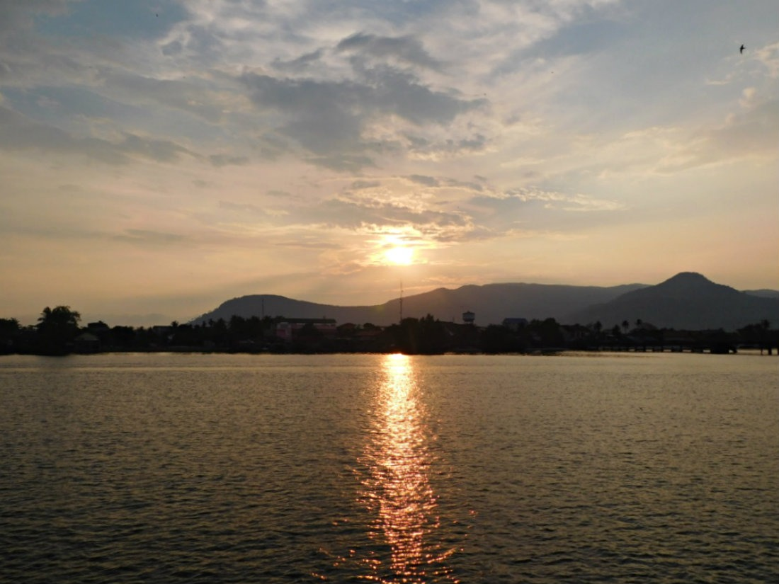 Watching the sun set over the river is one of the best things to do in Kampot