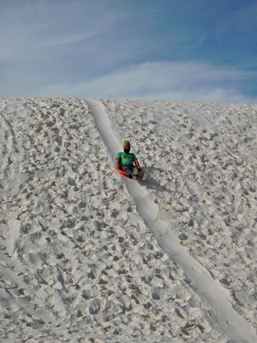 Sledding down the dunes at White Sands National Monument in New Mexico