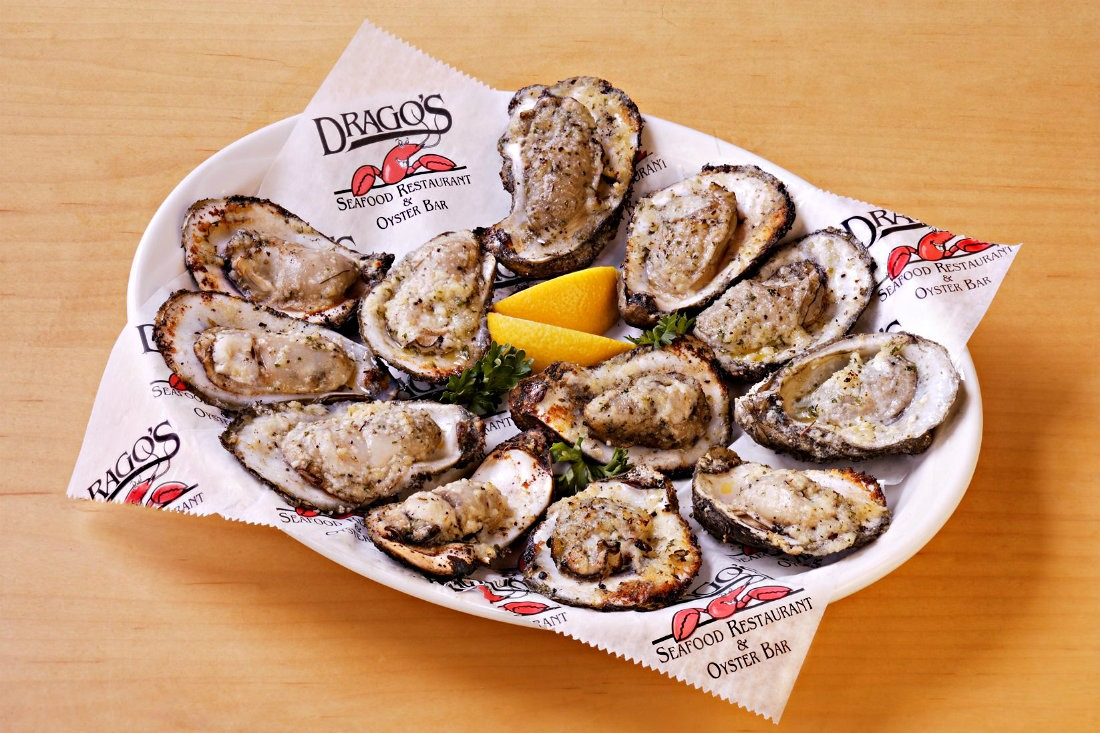 Eating charbroiled oysters at Drago's in New Orleans is a top Louisiana food experience