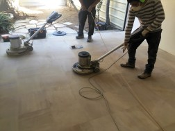 Grinding sandstone flat to groutlines and honing to a beautiful smooth finish