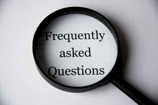 Frequently Asked Questions (FAQ) - text inside a magnifying glass