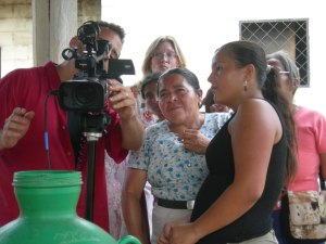 Friends from El Mozote check out the film equipment