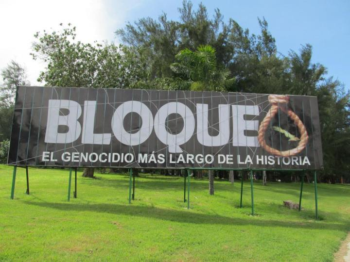 "Billboard reading ""The embargo: the longest genocide in history"""