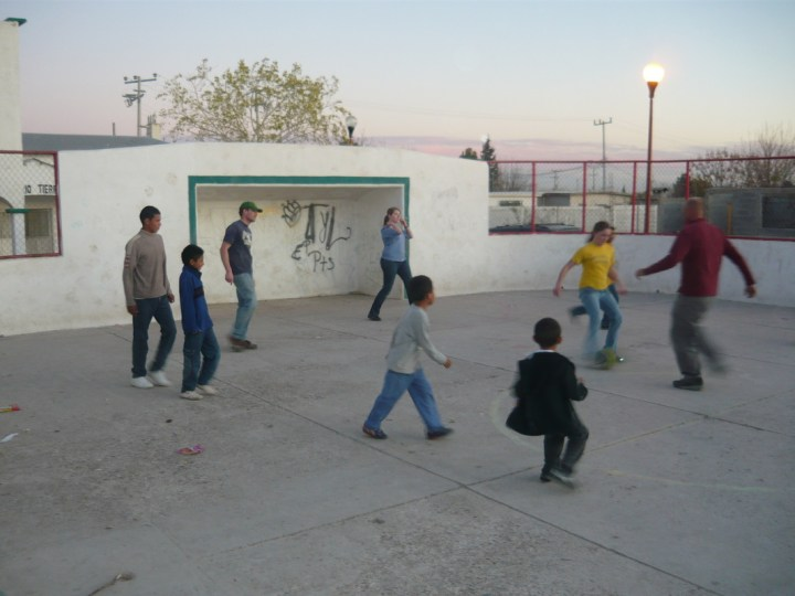 Playing soccer with the neighborhood kids