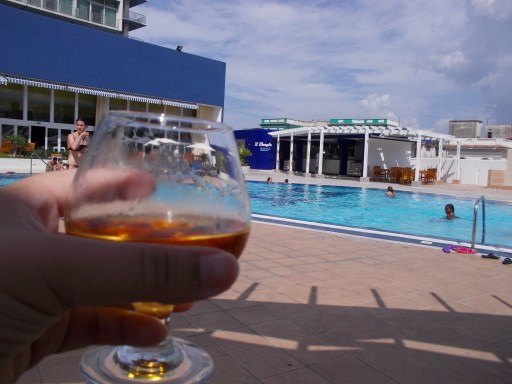 Glass of rum poolside
