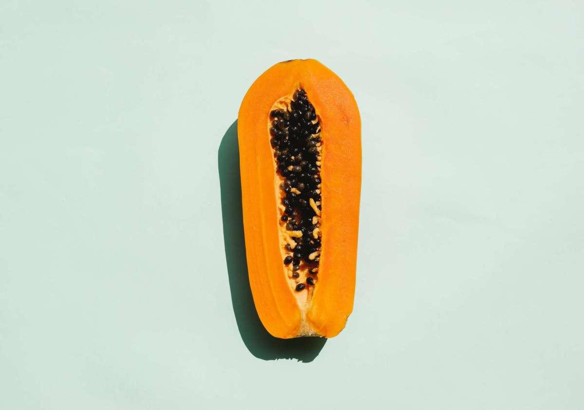 half of exotic ripe papaya with seeds