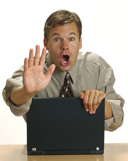Man with porn on computer © Czuber | Dreamstime.com