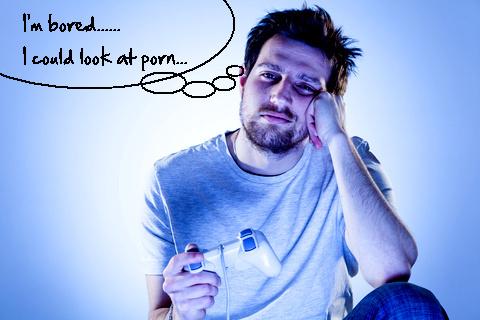 Bored man thinking of looking at porn. © Mrkornflakes | freedigitalphotos.net