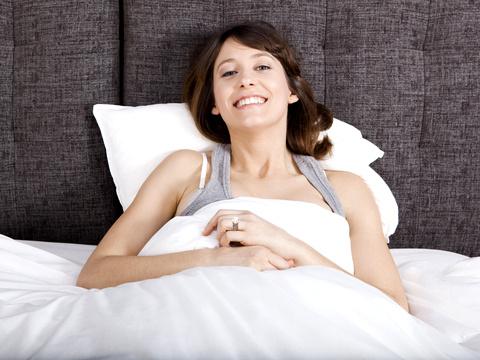 Happy in Bed © Erik Reis   dreamstime.com