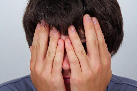 Embarrassed teenage boy  © Klaus Eppele | dollarphotoclub.com