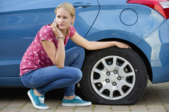 Woman with flat tire © flairimages   dollarphotoclub.com