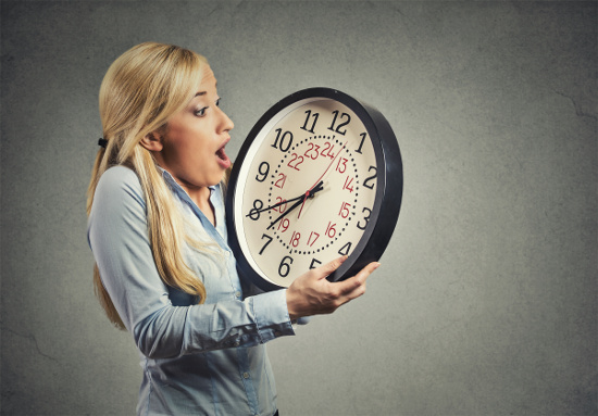 Shocked woman looking at clock © pathdoc | stock.adobe.com