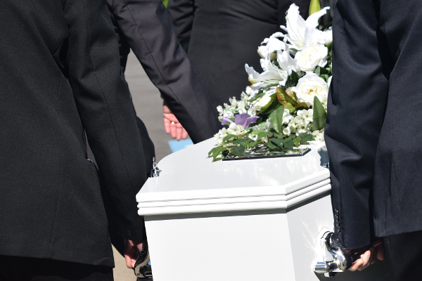 Men carrying coffin