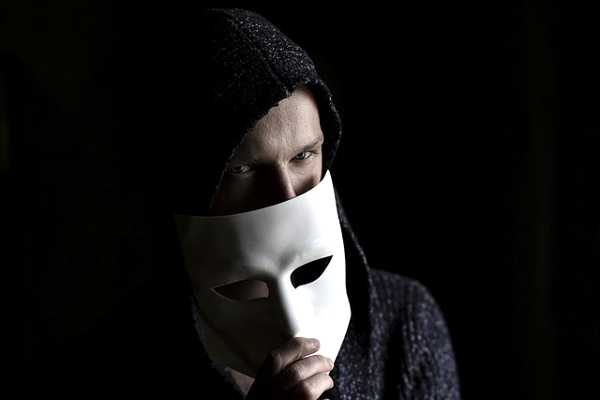 Man hiding behind mask