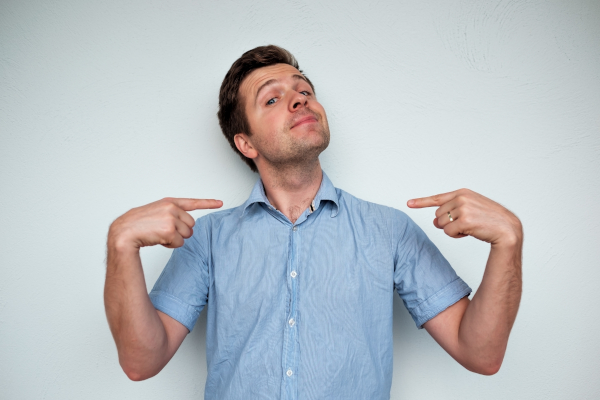 Man pointing to himself to show he is right.