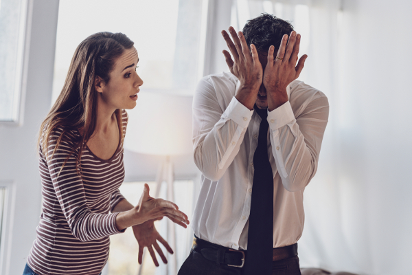 Husband embarrassed by wife's words.