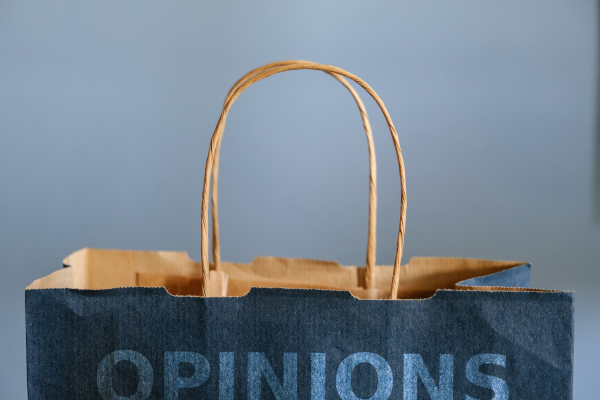 """Shopping bag with """"Opinions"""" written on it."""
