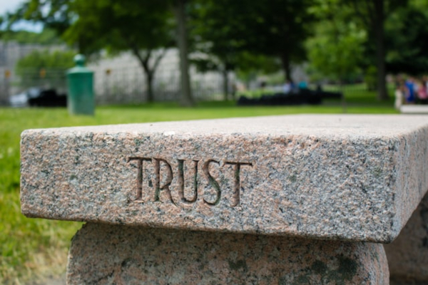 """Pillar with """"Trust"""" written on it."""