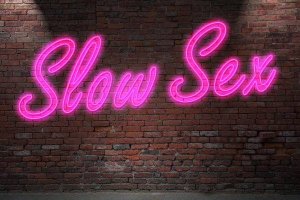 Neon spelling out Slow Sex